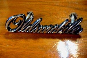 1976-77 Oldsmobile Cutlass Grill Emblem OEM