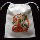 "Letter D-cross stitch on 8""x 9""white denim drawstring pouch"