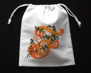 "Letter F-cross stitch on 8""x 9""white denim drawstring pouch"