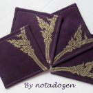 Nok Karb --a set of four 10cm.x10cm. gold color painted on violet linen coasters