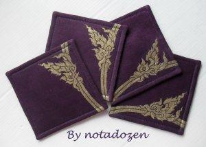 Nok Karb --a set of four 10cm.x10cm. gold color painted on violet linen coasters
