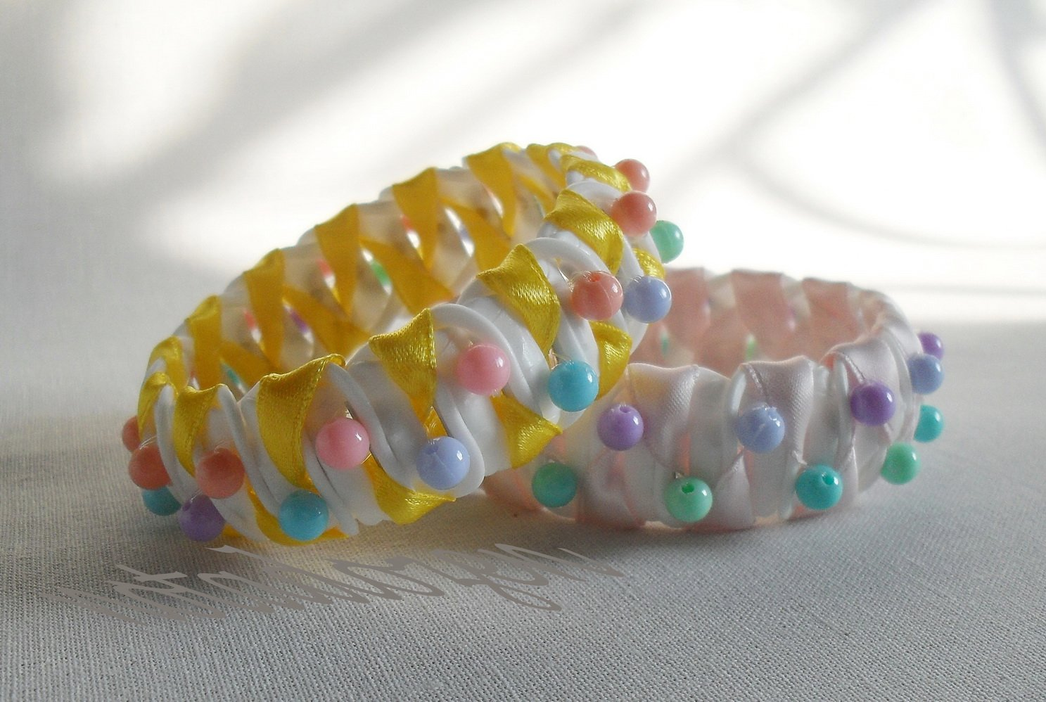 Recycled Bottle Caps Bracelet/bangle handmade (7)-yellow/sweet pink ribbon wrapped and color beads