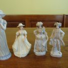 Four ceramic figurines