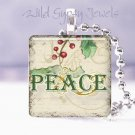 "Vintage PEACE holly sprig CHRISTMAS 1"" glass pendant"