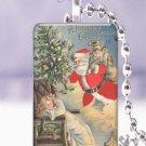 "Vtg. Santa Christmas tree child postcard 1 x 1.5"" glass tile pendant necklace"