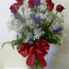 One dozen roses inside vase