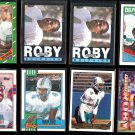 REGGIE ROBY (8) Card Lot (1985 - 90's) w/ Gold.  DOLPHINS / REDSKINS