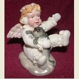 SNOW ANGEL FIGURINE HOLDING BABY SEAL