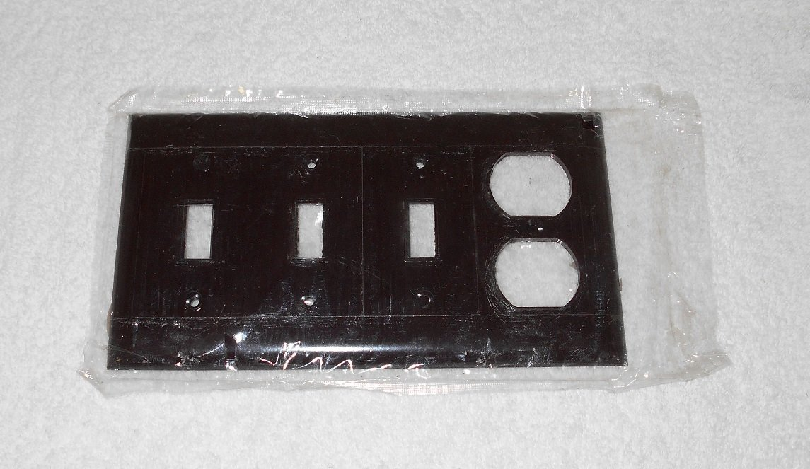 Sierra Electric - Triple Switch, Single Outlet Wallplate - Fluted - Brown Bakelite - Vintage - New