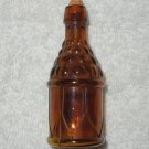 Small Brown Glass Bottle With Embossed Design - Original Cork Included - Needs To Be Cleaned