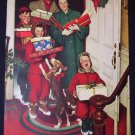 Plymouth Home for Christmas 1950 Norman Rockwell National Geographic advertisement