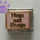 Hugs not Drugs Italian Charm on a pink glitter enamel background