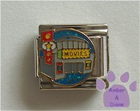 Movie Theater Italian Charm on a blue glitter disc
