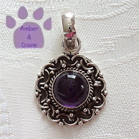 Amethyst Round Sterling Silver Pendant in a scalloped frame