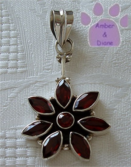 Faceted Garnet Flower Sterling Silver Pendant with garnets