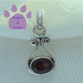 Garnet Oval Sterling Silver Pendant in a simple frame