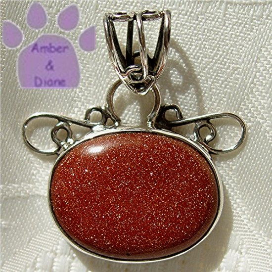 Goldstone Oval Sterling Silver Pendant in a filigree frame