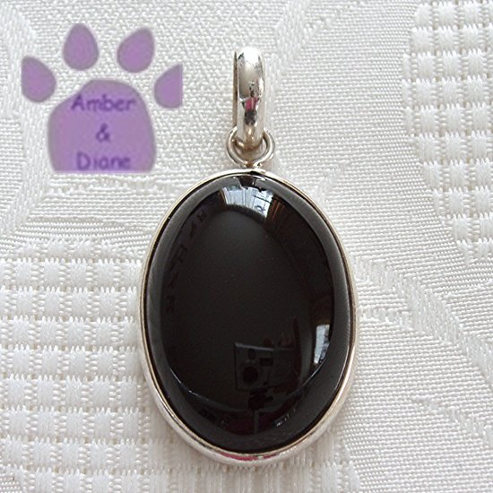 Onyx Sterling Silver Pendant Black Oval in a simple silver frame