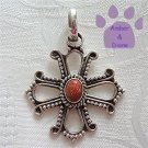 Sunstone Oval Sterling Silver Pendant in an intricate cross frame