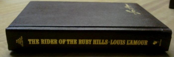 """Louis L'Amour """"The Rider of The Ruby Hills"""" Leather? EXCELLENT"""