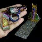 665CTS UNHEATED RHODOLITE GARNET, ZIRCON & SAPPHIRE GUN FIGURINE
