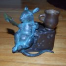 Mouse sitting in a cheese wedge, reading book, multi metal finish candlestick