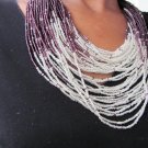 purple and white multi-string necklace