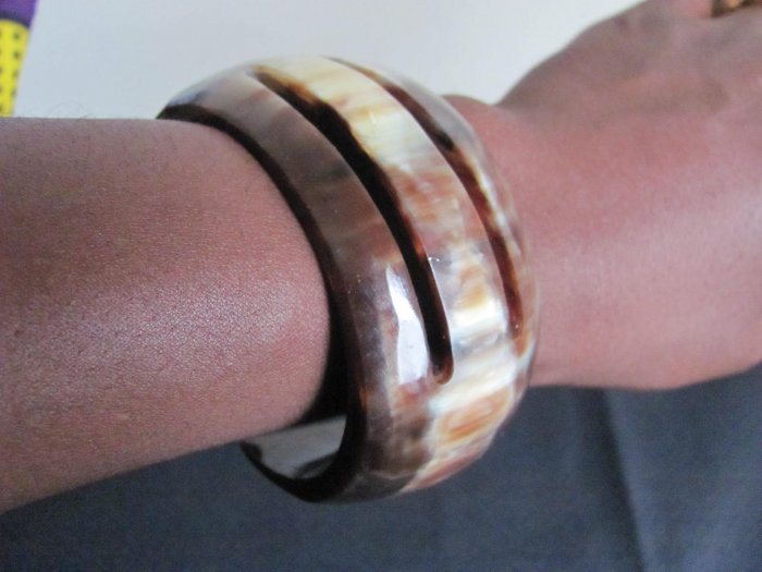 white and brown round bracelet