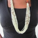 long white and brown multi-string necklace