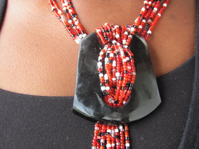 black white and red multi-string necklace
