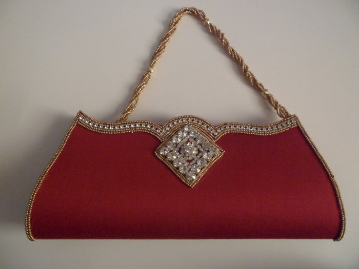 Red color Beaded border and Handle party clutch/purse