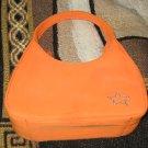 orange star-studded hand purse