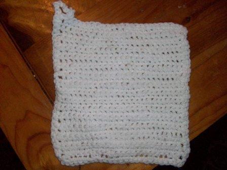 Crocheted white hand made potholder