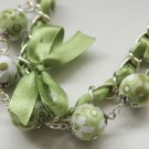 Apple green cotton beads and green satin ribbon bracelet