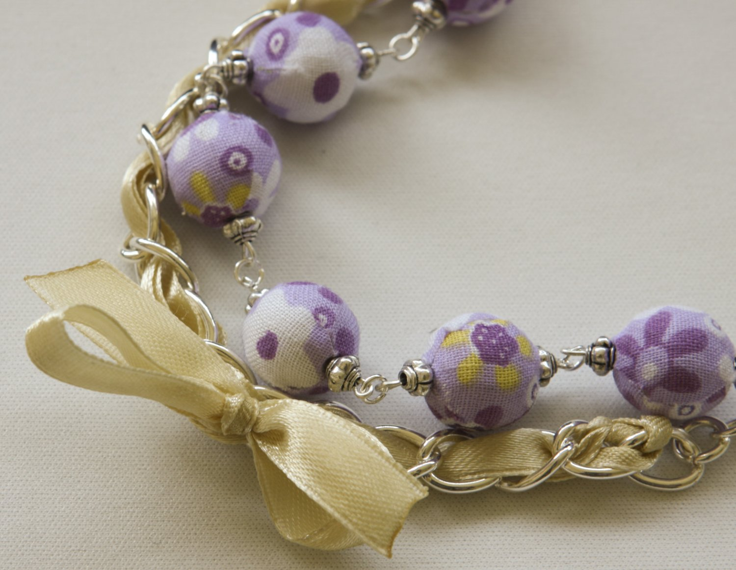 Violet cotton beads and yellow satin ribbon bracelet