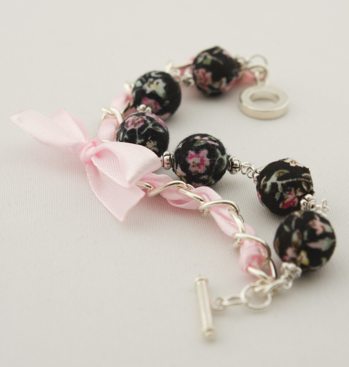 Black floral cotton beads and rose satin ribbon bracelet