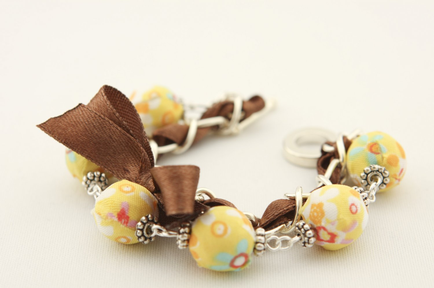 Yellow floral cotton beads and brown satin ribbon bracelet