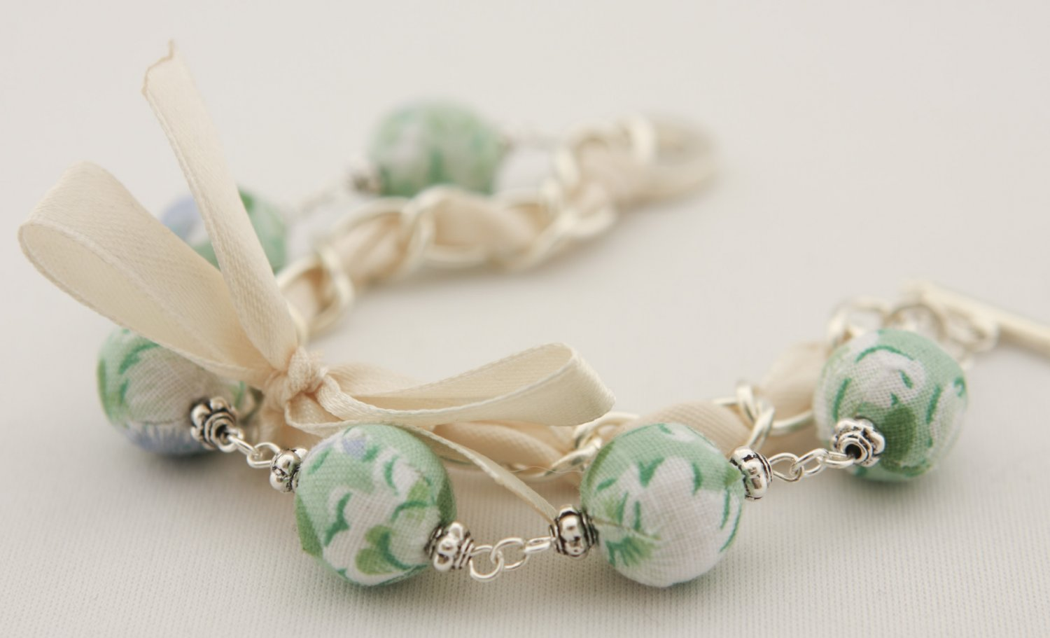 Light green floral cotton beads and beige satin ribbon bracelet