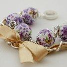Purple cotton beads and yellow satin ribbon bracelet