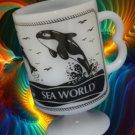 VINTAGE SEA WORLD PEDESTAL MILKGLASS MUG CUP B HANDLE