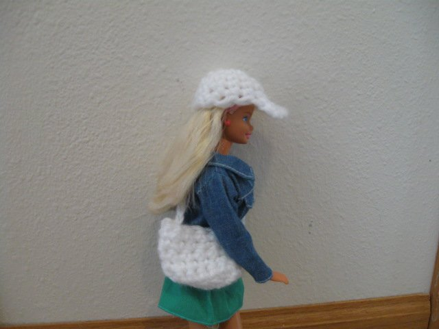 White baseball cap and purse