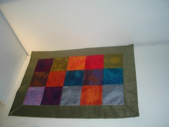 Patchwork placemat in green