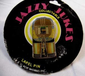 JAZZY JUKES 1946 AMI MODEL A ENAMEL PINBACK MINT CARDED