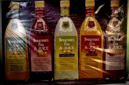 NEAT COLORFUL SEAGRAMS FLAVORED GINS BOTTLES TIN SIGN