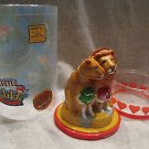 Plastic figural bank depicting a lion and lioness with a red and green M and M's