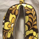 Vintage 1960s-70s vinyl brown / yellow flowered tote bag and is a zippered bag