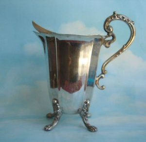 LARGE SILVERPLATE WATER PITCHER W PAW FEET
