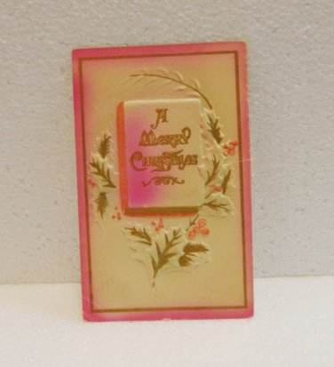 A merry Christmas embossed vintage postcard pink posted 1912 with stamp used PC AL1526