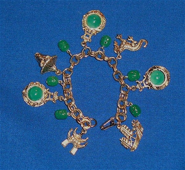 Vintage Bracelet Circa 1970s Oriental Designs with Green Glass
