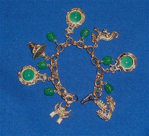 Vintage Bracelet Circa 1970s Oriental Designs with Green Glass